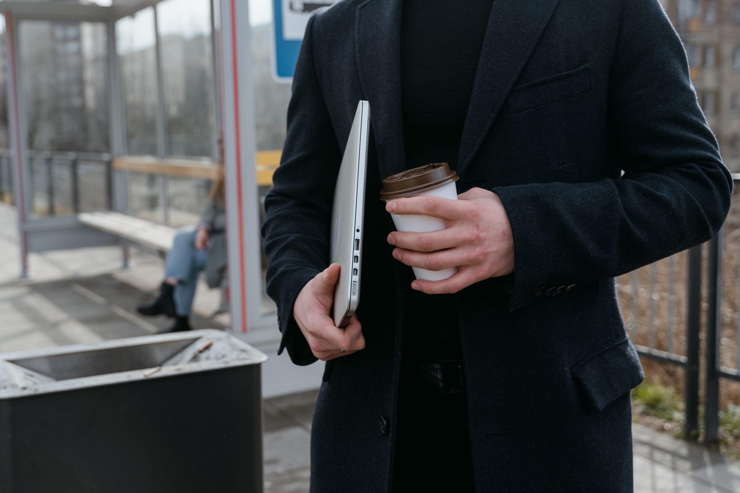 man holding his Mac Pro